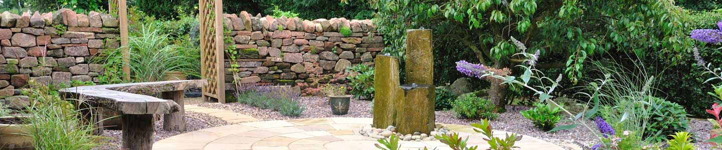 Photo: low maintenance garden and water feature